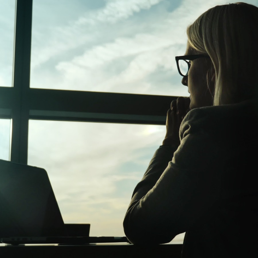 picture of women looking out office window