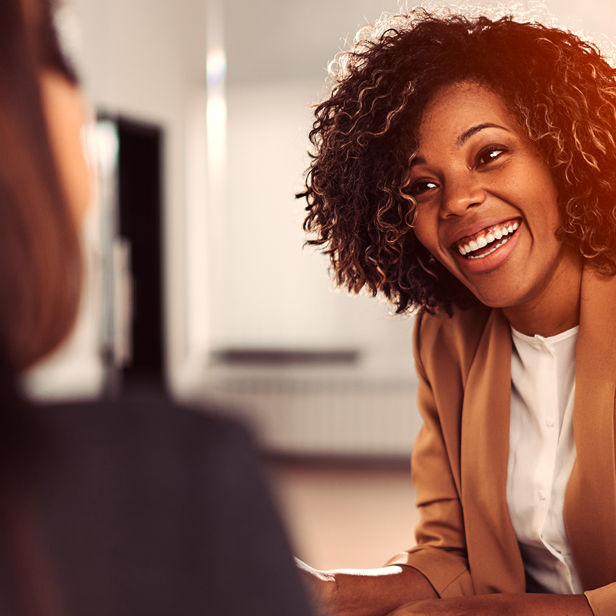 Picture of woman smiling at another person