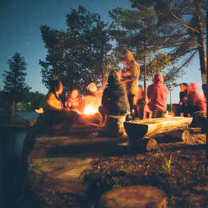 picture of people around a campfire
