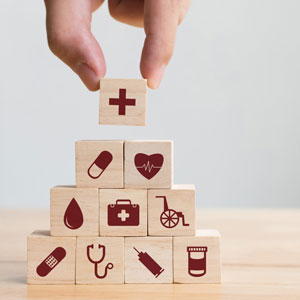 Picture of wooden blocks with various pictures representing the health care field