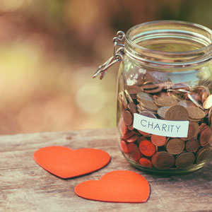 Picture of jar labelled charity filled with spare change