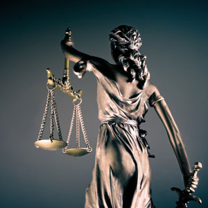 Female statue holding scales of justice