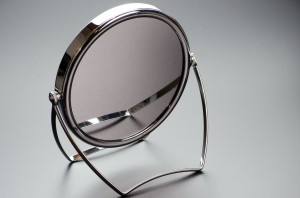 A tabletop face mirror