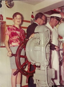 Photo of John at age 11 at the helm of the MS Gripsholm