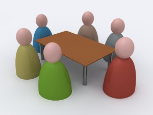 Toy people at a table