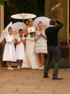 Bridal party coping with rain