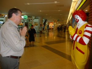 John and Ronald McDonald exchanging a wei