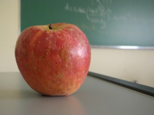 Apple on a teacher's desk