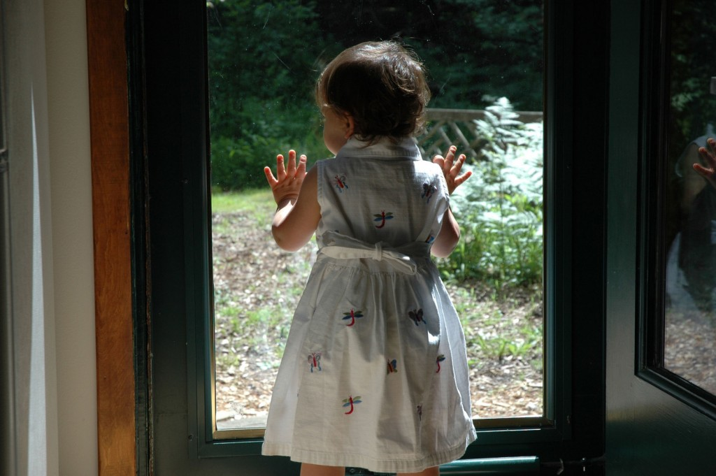 Girl looking out window