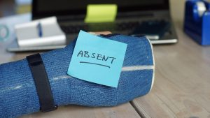 iStock photo of an arm cast with a post it note that says absent.
